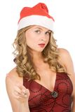 Blonde Mrs Santa Claus makes warning finger sign Royalty Free Stock Photo