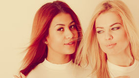 Blonde and mulatto girl together. Friends dialogue between cultures. Blonde and mulatto girl together. Two young beautiful ladies, one has bright hair, second Stock Photos