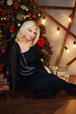 Blonde near the Christmas tree Stock Photography