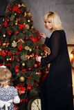 Blonde near the Christmas tree Royalty Free Stock Images