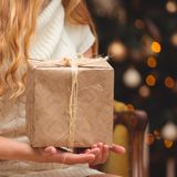 Blonde near the Christmas tree stock images