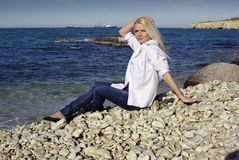 Blonde near the sea Royalty Free Stock Photo