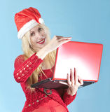 The blonde in a New Year's hat  with  red laptop Stock Images