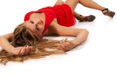 Blonde no vermelho Imagem de Stock Royalty Free