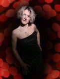 Blonde no vestido preto Fotos de Stock Royalty Free