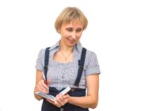 Blonde with notepad Royalty Free Stock Image