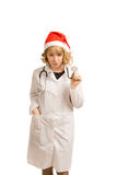 Blonde nurse in a Santa Claus hat Royalty Free Stock Images