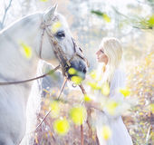 Blonde Nymph With The White Horse Royalty Free Stock Image