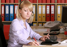 Blonde in office. Photo of young women  in office Royalty Free Stock Photography