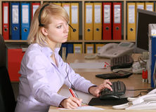 Blonde in office Royalty Free Stock Images