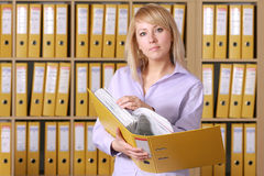 Blonde in office. Photo of young women in office Royalty Free Stock Photos