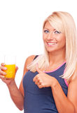 Blonde with orange juice showing thumbs up Stock Image