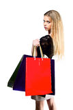 Blonde with paper bags with copy space isolated white background Royalty Free Stock Images