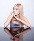 Blonde with pearl beads Stock Image