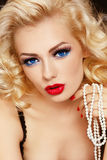 Blonde with pearls Stock Photo