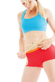Blonde and perfect shaped woman measuring her waist fitness Royalty Free Stock Photo