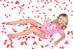 Blonde in petals Stock Photography