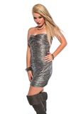 Blonde. Petite young blonde in a strapless silver lame dress Royalty Free Stock Photos