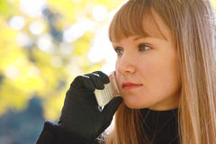 Blonde with phone looks right Royalty Free Stock Image