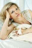 Blonde on pillows Stock Images