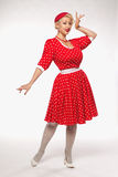 Blonde in pin-up. Young beautiful blonde in red dress pin-up in the studio royalty free stock images