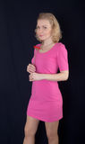 Blonde in a pink dress Royalty Free Stock Photography