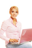 Blonde with pink laptop Stock Photo