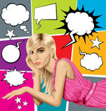 Blonde in pink lies on a floor and speech bubbles Royalty Free Stock Photos