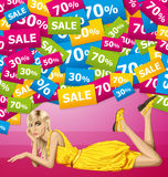 Blonde in pink lies on a floor Royalty Free Stock Photo