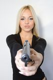 The blonde with a pistol Stock Image