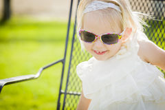 Blonde Playful Baby Girl Wearing Sunglasses Outside at Park Stock Images