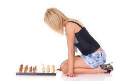 blonde playing chess Stock Photography