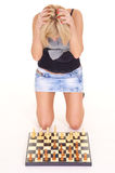 blonde playing chess Stock Photo