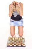 blonde playing chess Stock Photo