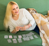 Blonde playing game of cards Stock Photo