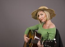 Blonde Playing Guitar Royalty Free Stock Image