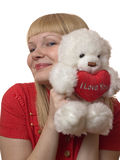 Blonde with a plush toy royalty free stock photography