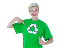 Blonde pointing her recycling tshirt. Pretty blonde pointing her recycling tshirt Stock Photo
