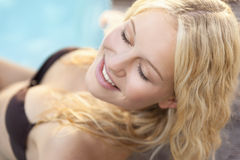 Blonde in the pool Royalty Free Stock Photos