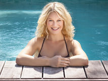 Blonde in the pool Royalty Free Stock Photo