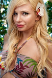 Blonde portrait with flower royalty free stock photography