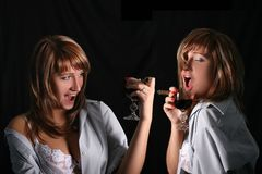 Blonde posing with a beaker of wine Stock Image