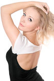 Blonde posing in black-white dress Royalty Free Stock Image