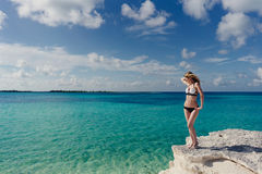 Blonde posing on the edge of a cliff Caribbean Sea Royalty Free Stock Photos