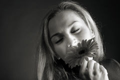 Blonde posing with a flower Royalty Free Stock Photography