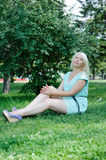 Blonde posing on the grass Stock Photography