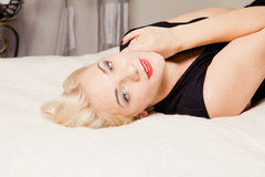 Blonde posing lying on her back Stock Photography