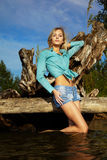 Blonde posing near flotsam Royalty Free Stock Photography