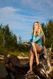 Blonde posing near flotsam Royalty Free Stock Photos