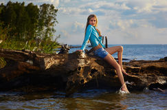 Blonde posing near flotsam Stock Photos